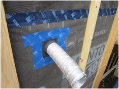 Installing Roflex gasket with TESCON tape at duct penetration. Credit: Eco Homes of Vermont