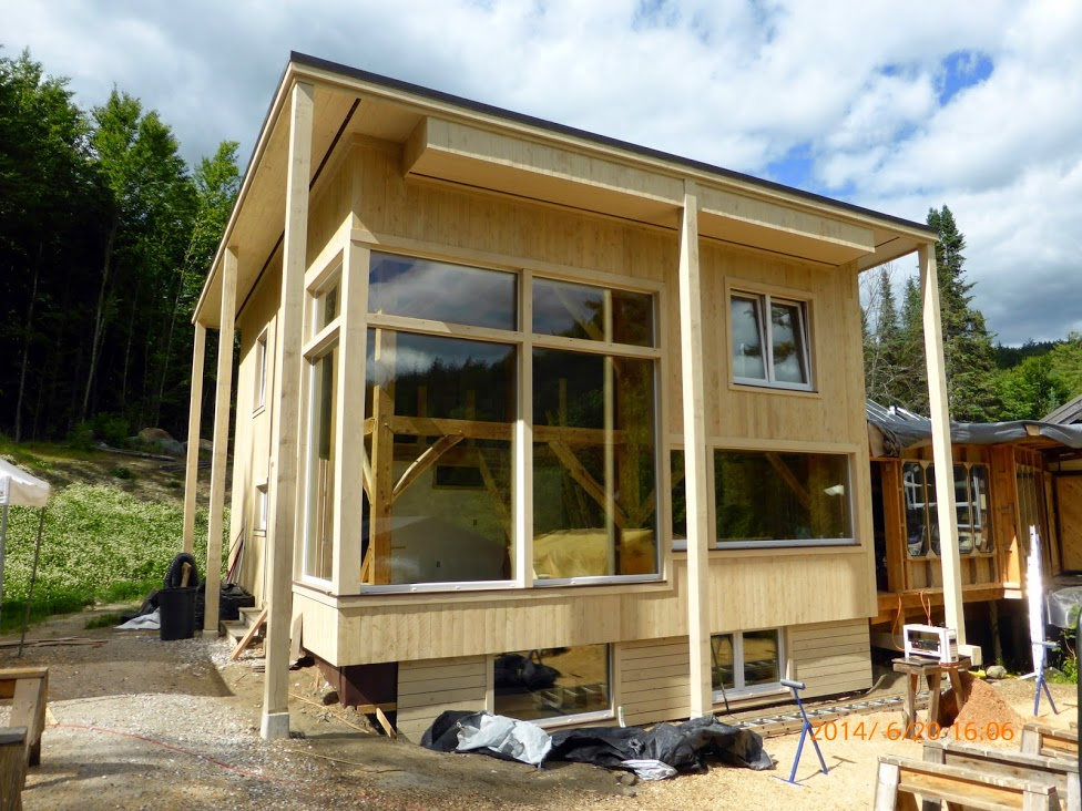 Whitchurch Passive House - with storefront windows show the post&beam structure behind